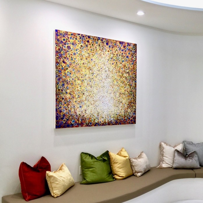 """The painting """"Peal"""" by Randall Stoltzfus installed in a patient waiting area"""