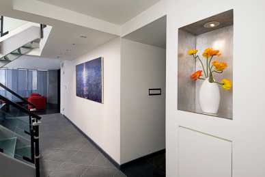 "Installation view showing the painting ""Slip"" by Randall Stoltzfus ihanging in the entry of a Manhattan penthouse apartment"