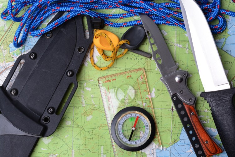 Equipment for survival. Map, knife, rope, compass, fire striker.
