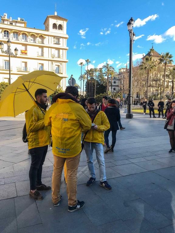 Yellow dressed guys with umbrella
