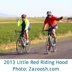 color photo of 2 women cyclists at 2013 Little Red Riding Hood women's only bike ride; photo by Zazoosh.com