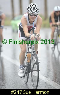 Photo of 2013 Ironman 70.3 World Championship competitor Sue Harmon on a wet bike course in the rain