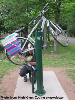 A cyclist repairs his bicycle using public bike repair station. Photo credit to High Knees Cycling