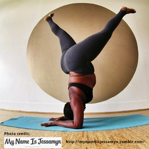 Color photo of Ja variation of pincha mayurasana by Jessamyn