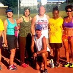 Color photo of several Vegas Sizzling Seniors members, a track and field team for athletes age 50 or better.