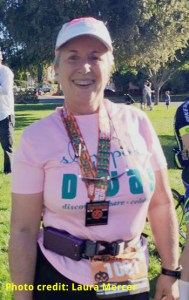 Bonnie Parrish-Kell wearing finisher medal at 2015 Pumpkinman Triathlon's 5K race