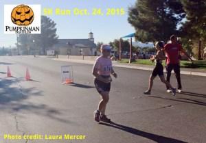 Color photo of Bonnie Parrish-Kell approaching Pumpkinman 5K finish line