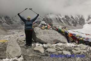 Karen Whelan holds trekking poles overhead at Everest Base Camp in 2012
