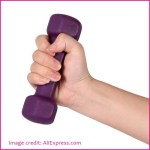 female hand holding a purple dumbbell weight