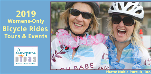 two women cyclists posing for camera