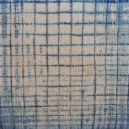Indigo and coffee on linen with decorative stitching