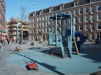 A completed playground in the space between buildings