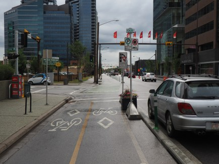 Planter protected intersection on 12th Avenue with phased bicycle signal