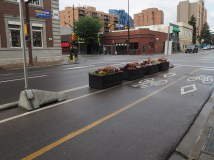 Planter protected intersection on 12 Avenue