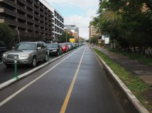 Parking protected 12th Avenue with modular curbs and plastic bollards