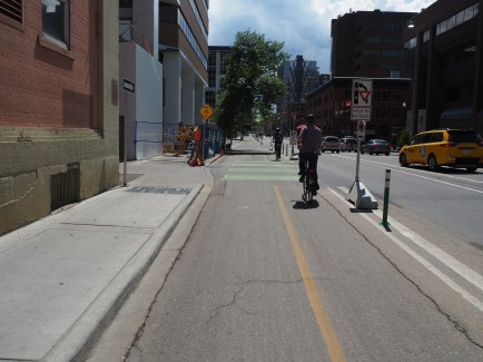 Barriers and bollards used to protect 5th Street mid-block section at driveway