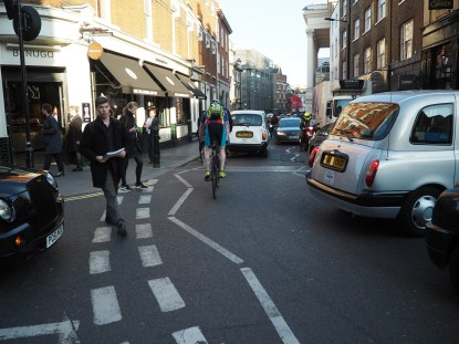 Bumper to bumper vehicle congestion in London's Soho neighbourhood which makes it uncomfortable for people walking and cycling.