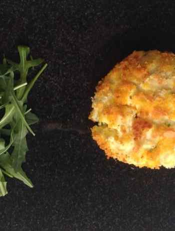 A breaded stuffed mushroom served with arugula