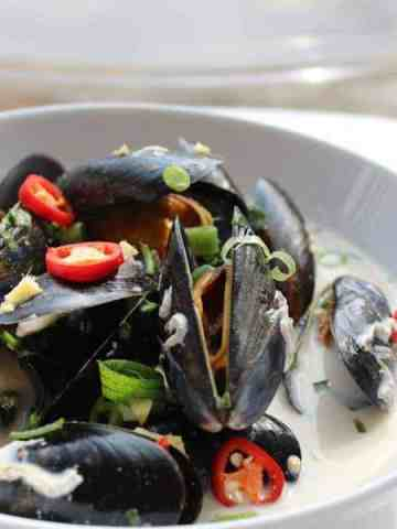 Thai Mussels in a white bowl