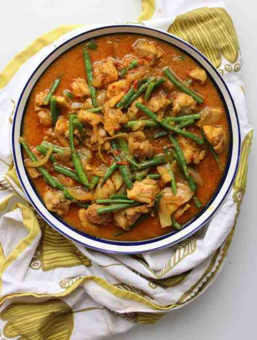 Malaysian chicken in a bowl on a green cloth