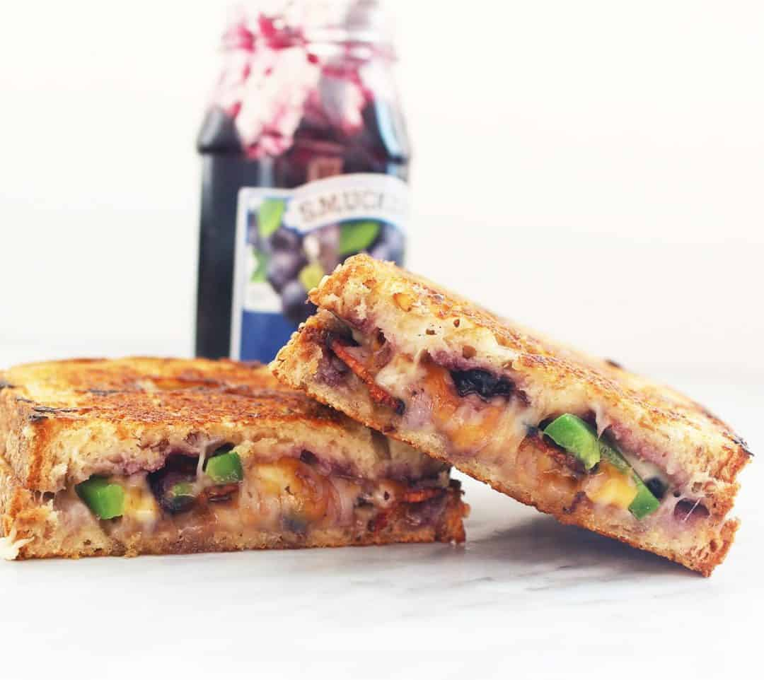 My Hot Berry Blueberry Grilled Cheese is quick and easy to make and super indulgent! Packed with cheese, jalapeno, blueberry and bacon. You can't get a better grilled cheese!! Grilled Cheese  Blueberry Grilled Cheese   Easy Grilled Cheese   Grilled Cheese with Bacon   Bacon and Blueberry   Spicy Grilled Cheese #grilledcheese #grilledcheesesandwich #blueberrygrilledcheese