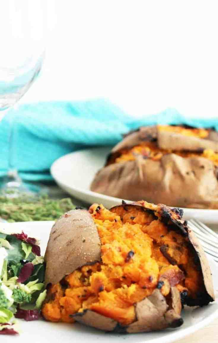 A twice baked stuffed sweet potato on a white plate
