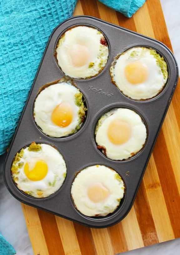 Bacon and egg cups in a muffin pan straight out of the oven
