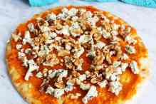Blue cheese pizza with pumpkin with blue cheese and walnut topping, un cooked