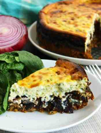 A slice of savoury cheesecake served with a side salad