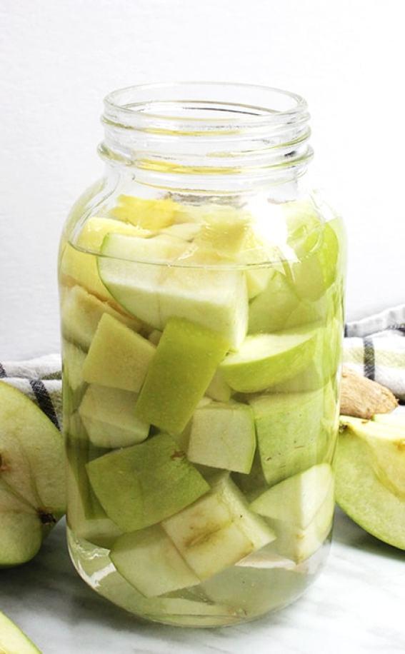 Green apple vodka in a glass jar