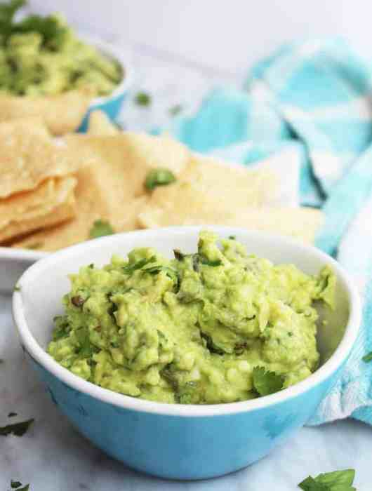 Close up of jalapeno guacamole in a blue bowl