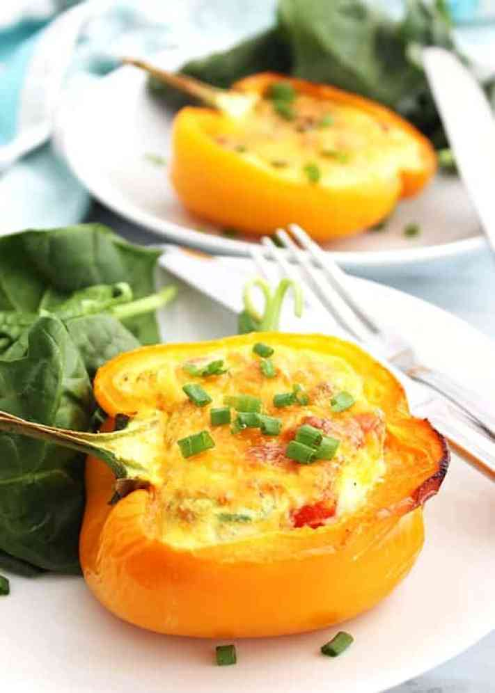 Breakfast stuffed peppers served on a white plate