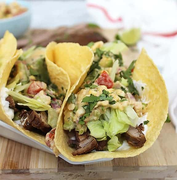 A flank steak taco with toppings folded