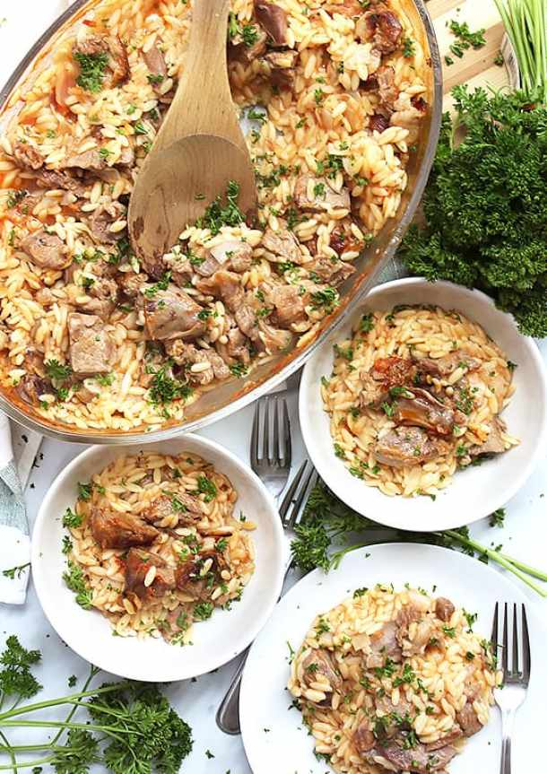 Giouvetsi in a large casserole and served into three portions