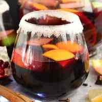 Close up of a sugar rimmed glass of red wine sangria