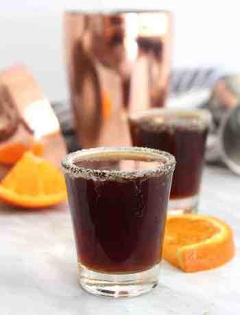 A chocolate orange shot next to an orange slice