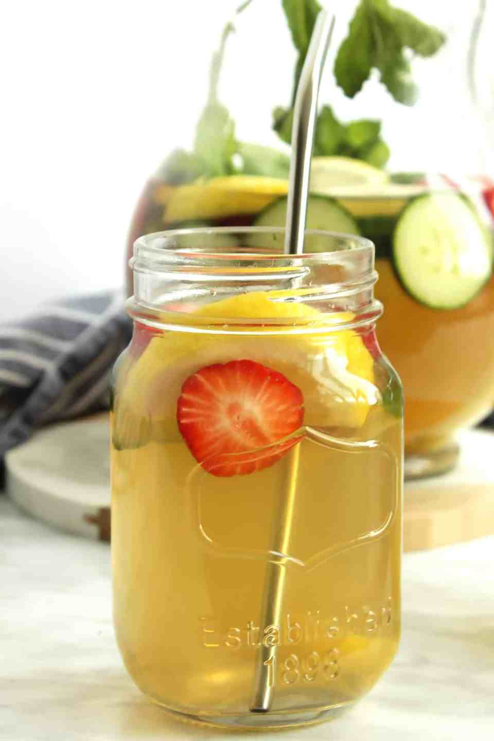 A glass of iced green tea with fresh fruit