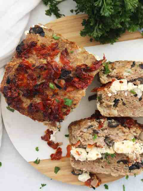 Slices of lamb meatloaf stuffed with feta cheese.