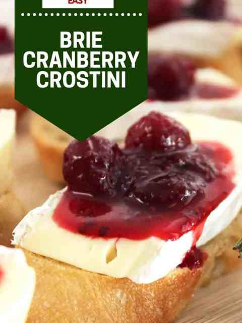 Pinterest graphic. Brie and cranberry crostini with text.