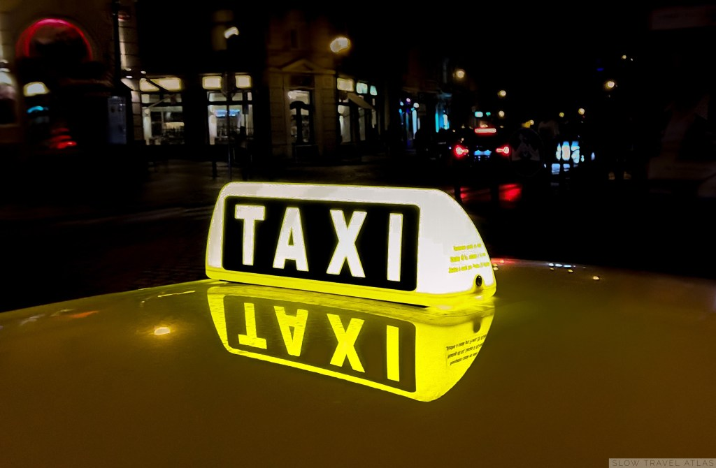 A lit-up taxi roof light