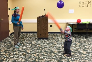 Young Jedi test their abilities with lightsabers.