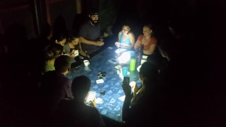 A little tropical storm and power outage won't stop this game of Cards Against Humanity