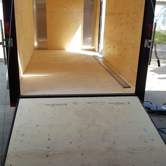 Trailer as delivered-no tie off points, bracketry, plain plywood