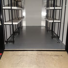 Rolling shelves installed along with heavy duty brackets welded to trailer frame for E-Track tie down system