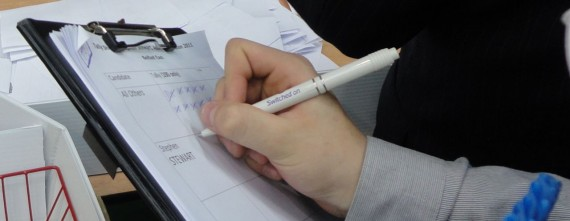 Stephen Stewart tallying East Belfast Assembly ballots - closeup