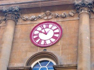 """The clock on the Bristol Exchange giving priority to local time, but also indicating """"railway time"""", 10 minutes ahead."""