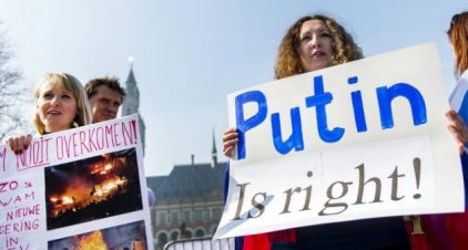 Pro-Russian supporters stage a protest asking for the self-determination of Ukraine's Crimea peninsula, in front of the Peace Palace in The Hague, The Netherlands, on March 14, 2014. (REMKO DE WAAL/AFP/Getty Images)
