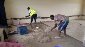 Volunteers Tiling the rooms.