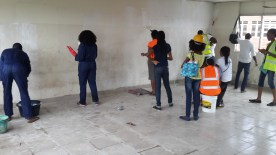 Volunteers doing final painting of the rooms.
