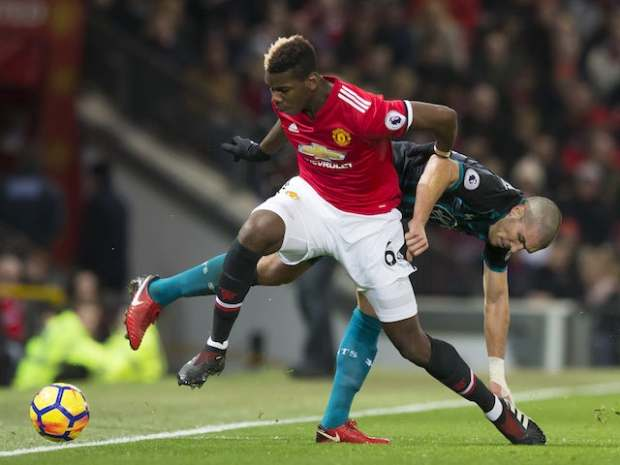 Paul Pogba and Oriol Romeu in action during the Premier League game between Manchester United and Southampton on December 30, 2017